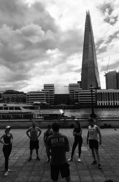 An outdoor fitness class on Billingsgate Walk